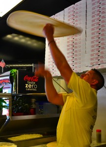 Owner Ray Anzola spins fresh dough while making a pizza.